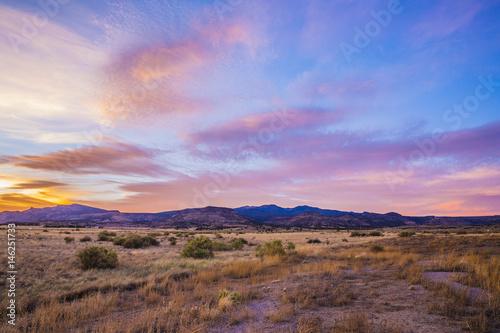 Foto op Canvas Diepbruine sunset over desert mountains
