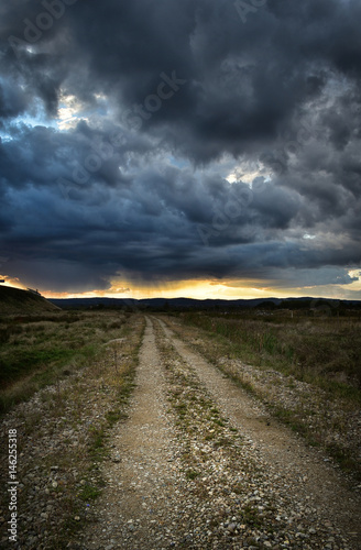 Dramatic storm sky in early Autumn Poster