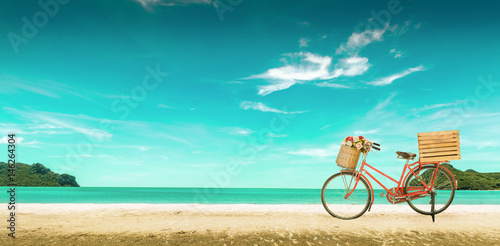 Fotobehang Fiets Red vintage bicycle on white sand beach over blue sea and clear blue sky background, spring or summer holiday vacation concept,vintage style.