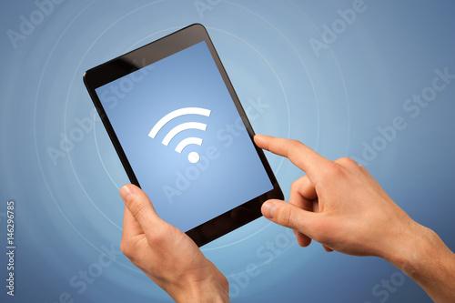 Female hand holding tablet