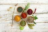 Spices and herbs on wooden background - 146320957