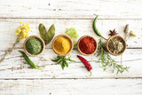 Spices and herbs on wooden background - 146320980