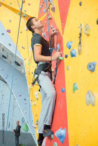 Young man on climmbing wall