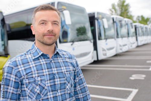 man posing in a row of coaches