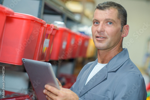 Man in storeroom with tablet