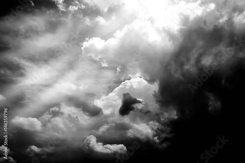 The Power of Sunlight and  storm Clouds in Black AND White Background. - 146359796