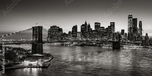 Black & White elevated view of the Brooklyn Bridge and Lower Manhattan skyscrapers at dusk Poster