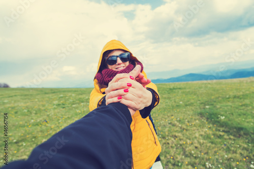 Poster Boyfriend and girlfriend enjoying on a big mountain meadow.