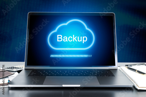 modern laptop on work desk with Cloud Backup concept
