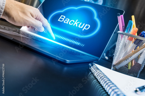 Foto Murales Businessman hand using modern laptop with Cloud Backup concept