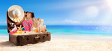 Beach Accessories In Suitcase On Beach - Travel Concept - 146627511