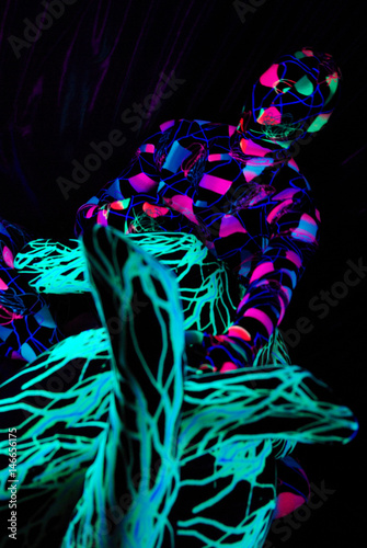 uv dancers in the nightclub wearing zentai catsuits Poster