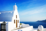 beautiful details of Santorini island - typical house with white walls and blue sea Greecer, retro toned