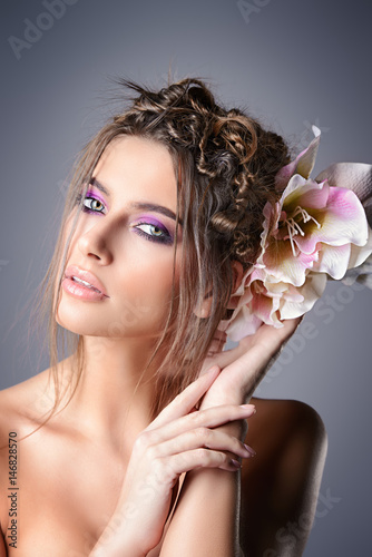 girl with flower in hair Poster