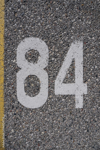 Poster Number on concrete
