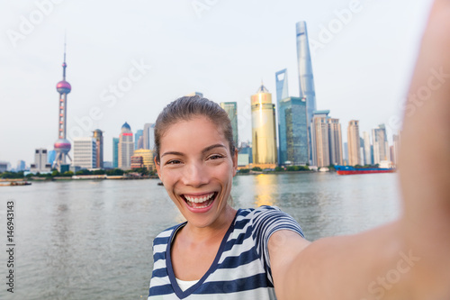 Happy Asian tourist woman taking selfie on The Bund Poster