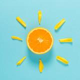 Orange slice as the sun concept