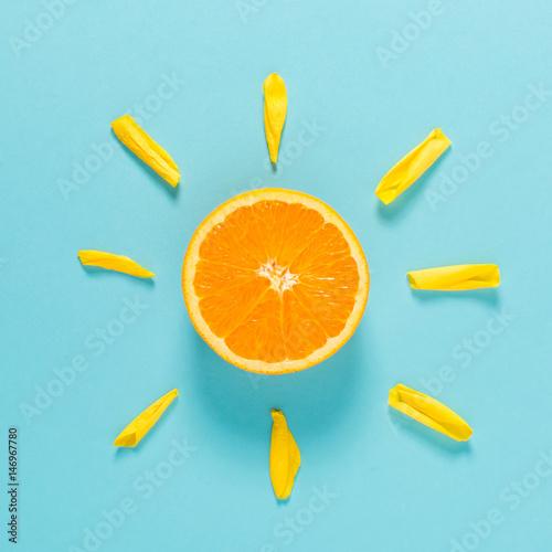 Pomarańczowy plasterek jako słońce pojęcie