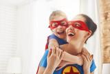 Fototapeta Girl and mom in Superhero costumes