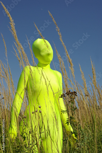 Poster ufo alien strange faceless creature on the field