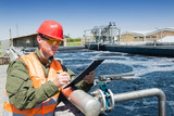An engineer controlling a quality of water ,aerated activated sludge tank at a waste water treatment plant, writing facts - 147086907