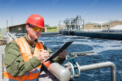 An engineer controlling a quality of water ,aerated activated sludge tank at a waste water treatment plant, writing facts