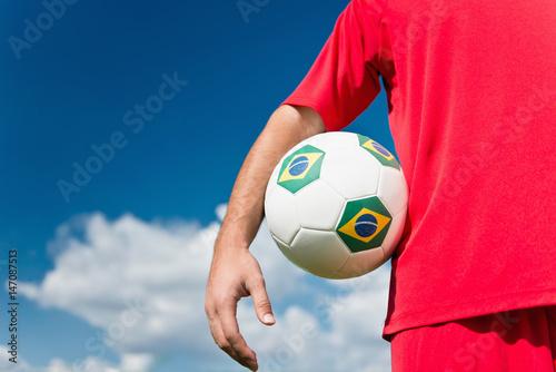 Plakat Soccer player holding Brazil ball