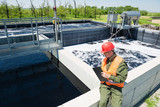 An engineer controlling a quality of water ,aerated activated sludge tank at a waste water treatment plant - 147087734