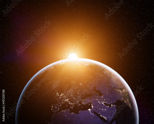Foto Murales Planet Earth with rising Sun, view from space. Elements of this image furnished by NASA