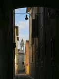 Narrow street in the old town of Pisa, Tuscany Italy