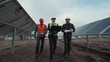Engineers discuss building of a solar farm with blueprints