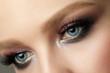 Close up of blue woman eye with smokey eyes makeup