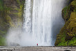 Tourist near Skogafoss waterfall in Iceland - 147252143