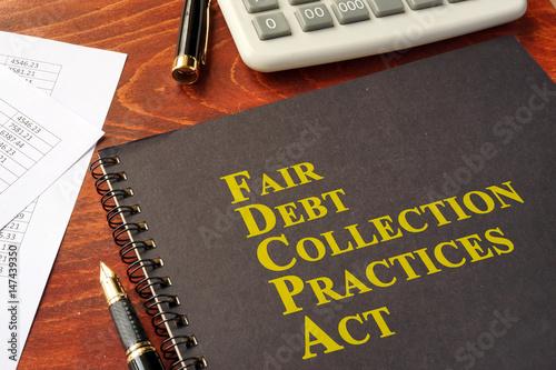Poster FDCPA Fair Debt Collection Practices Act on a table.