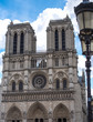 Ornate lantern stands before Notre Dame in Paris
