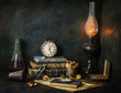 Classic still life with vintage books placed with old clock,lamp,cigar,nutcracker and bottle of drink on rustic background