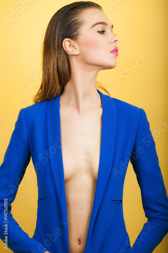 Sexy fashionable model in open blue coat with sexi breast Poster