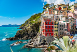 View of the colorful city of Riomaggiore in the gulf of the five lands in Italy