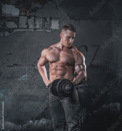 Bodybuilder with weight Poster