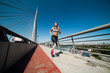 Woman running in urban environment