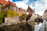 Architecture of Bruges city, traditional houses view on the canal
