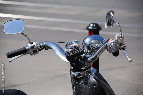 Handles, speedometer and rear view mirror of the motorcycle Poster