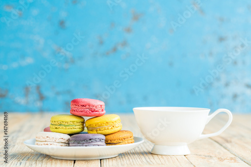 macarons on vintage wooden background. Macaron is sweet. Poster