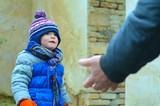 Hand unknown man lures a little boy - 147861734