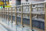 Chromium metal fence with handrail. Metal railings. Shallow depth of field. Selective focus. - 147868556