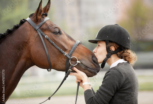 Attractive Young Woman Kissing her Horse