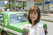 Asian girl looking for Tokyo taxi