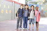 Multiethnic group of schoolchildren playing at school