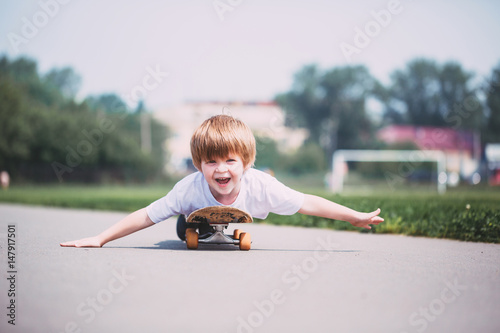 Plexiglas Skateboard Funny boy on a skateboard.