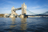 Bright scenic view of the landmark Tower Bridge above the River Thames in London, England  - 147925523